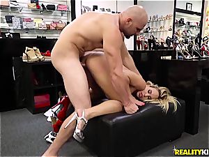 Olivia Austin screws the foot fetishist store clerk for a discount