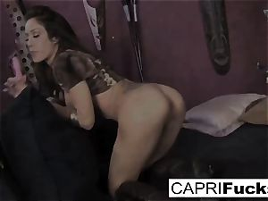 watch as busty sweetheart Capri pounds her taut moist cunt