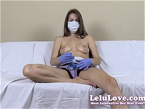 bra-less female with medical mask and strap dildo