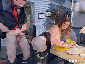Dani Jensen playing with bone in the office
