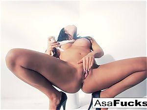 Asa Akira uses a fake hand to satiate her coochie