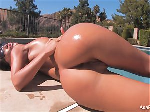 Everyone's fave porn industry star Asa teases by the pool