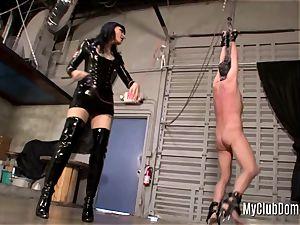 tied slave is flogged stiff by his mistress
