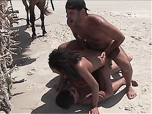 insatiable brazilian lady gets 2 rods on the beach