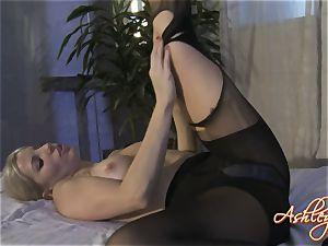 Ashley Fires ash-blonde female in black dress