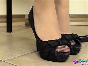 fantastic stunner undresses while wearing nylon stocking